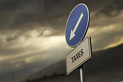 Taxes Road Sign With Arrow