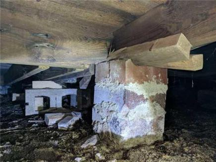 Failing brick and wood crawl space supports