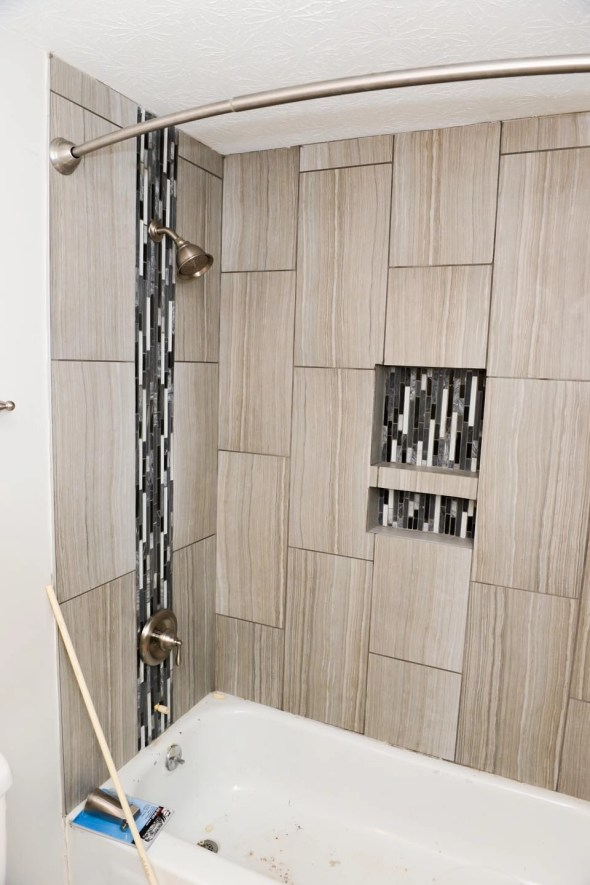 In-laid glass tile and in-set ledge.