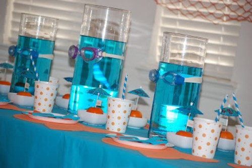 Orange and turquoise create a splash of color to this Under The Sea Party Kids Birthday Party! Including cute dessert table, place cards and party favors!