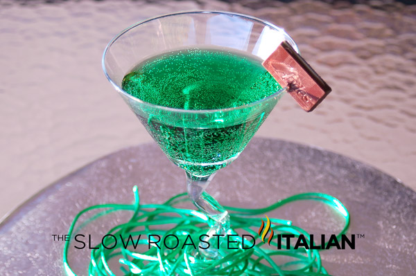 St. Patrick's Day Drink featuring green alcohol and mint chocolate in a martini glass