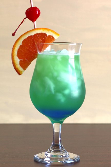 St. Patrick's Day Green and Blue Shamrock Juice with colorful fruit garnish
