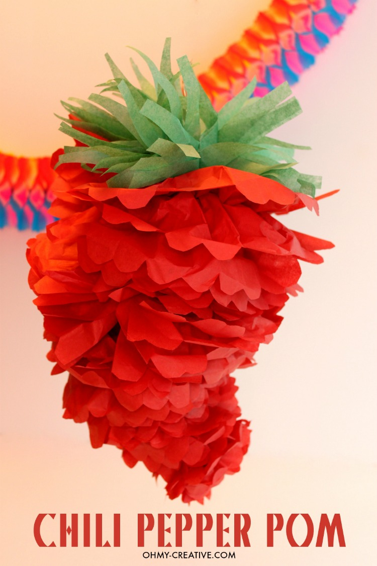 Chili Pepper Party Pom for Cinco de Mayo or a Mexican Fiesta! So cute and cheap to make using tissue paper! | OHMY-CREATIVE.COM