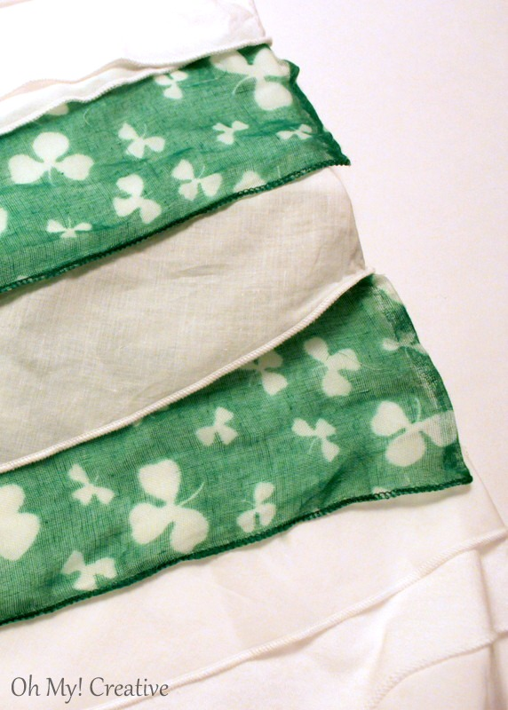 What an easy way to make a cheap DIY Woman's St. Patrick's Day T-Shirt using a ruffled t-shirt and a scarf! No sewing required! | OHMY-CREATIVE.COM