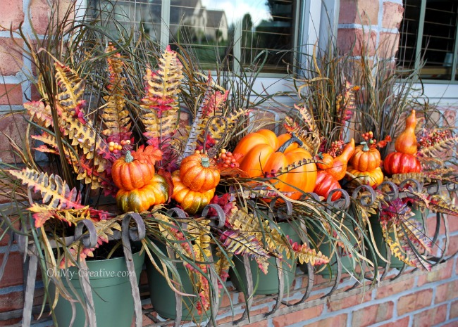 Fall Window Box with faux pumpkins and fall silk leaves