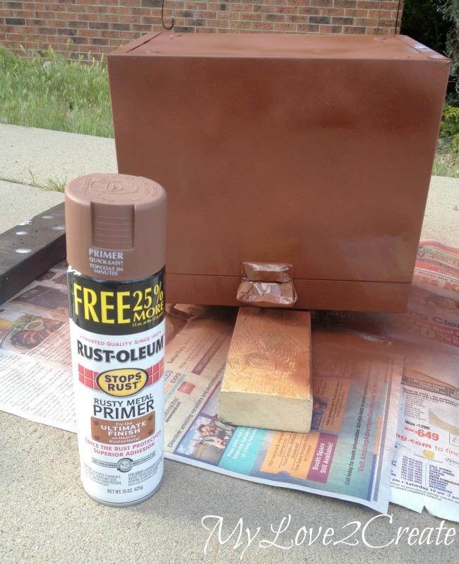 spray painting metal box with primer