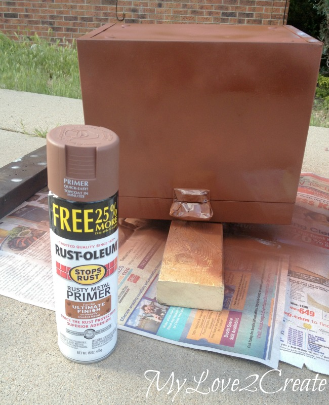 spray painting metal box with primer