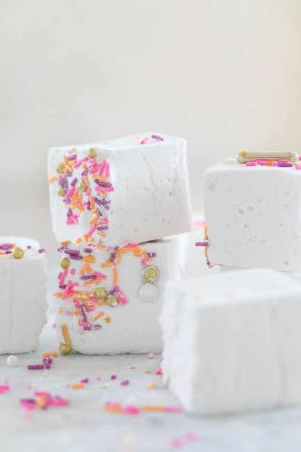 white marshmallow squares with pink and purple sprinkles