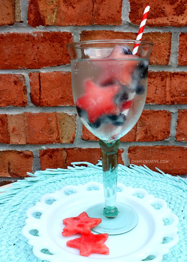 Fruit ice cubes in a glass