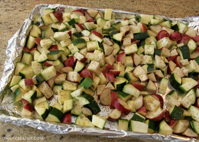 """This is one of my favorite """"go to"""" recipes. Not only is this Roasted Potatoes And Zucchini Side Dish easy to make it is also delicious and compliments any main course! 