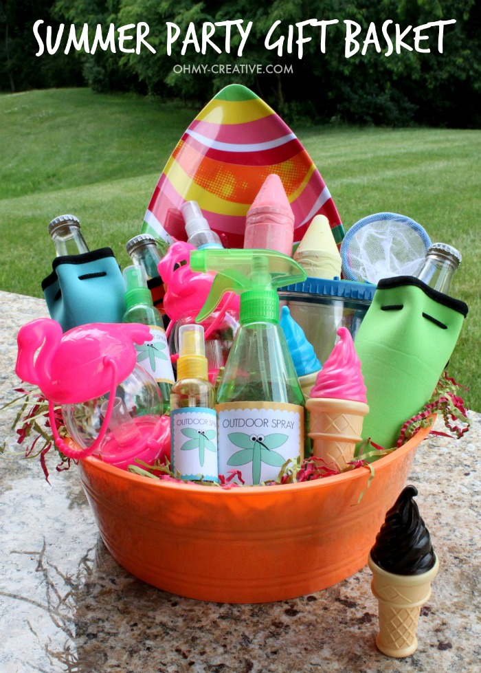 Do you never know what to bring for a summer hostess gift? Here is a super easy Summer Party Gift Basket you can put together in minutes with one trip to the dollar store! Fun ideas for fun outdoor actives! | OHMY-CREATIVE.COM