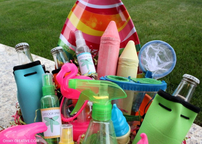 Do you need some ideas on what to bring for a summer hostess gift? Here is a super easy Summer Party Gift Basket you can put together in minutes with one trip to the dollar store! Fun ideas for fun outdoor actives!  |  OHMY-CREATIVE.COM