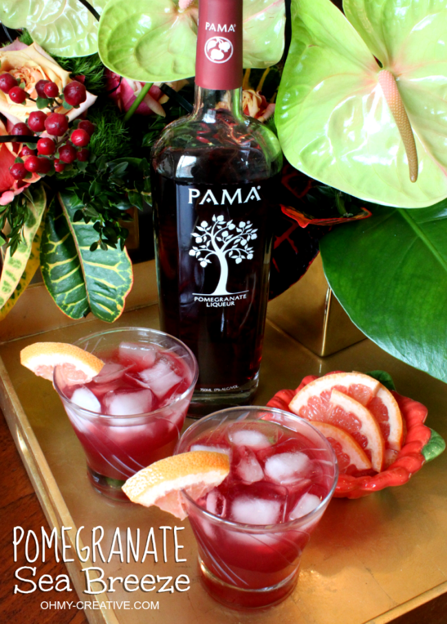 Do you love summer entertaining?! This Pomegranate Sea Breeze made with PAMA Liqueur is a light refreshing cocktail to serve for all summer celebrations! Yum! | OHMY-CREATIVE.COM