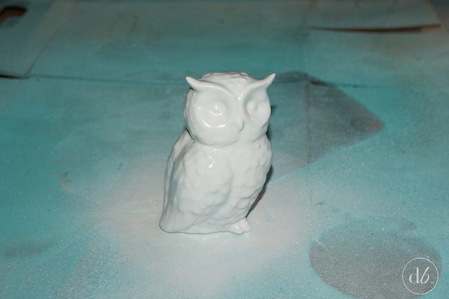 This Painted Dipped Owl can be created from any thrift store find. All it takes is two colors of spray paint, painters tape and it can be done in a few quick easy steps! Dwell Beautiful for OHMY-CREATIVE.COM
