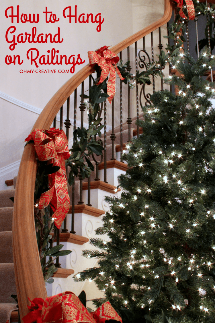 How to hang garland on staircase banisters oh my creative - Christmas decorations for stair rail ...