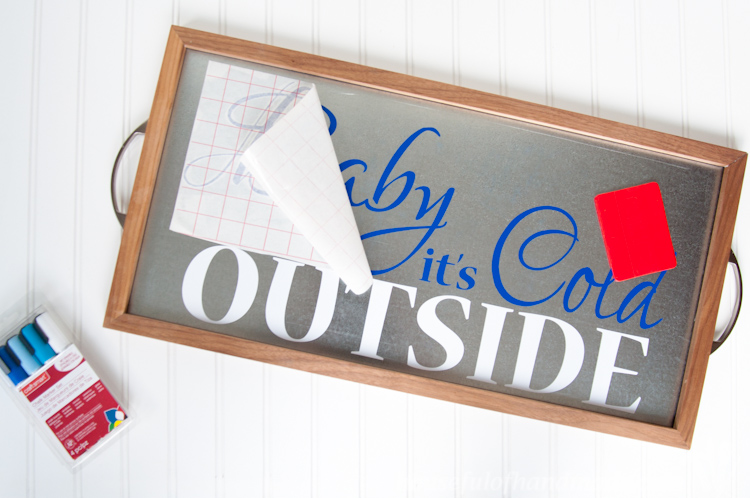 Baby It's Cold Outside is the perfect sign for a hot cocoa or coffee bar. Make this beautiful metal Winter Sign from DIY tray to add a little sparkle to it! | OHMY-CREATIVE.COM