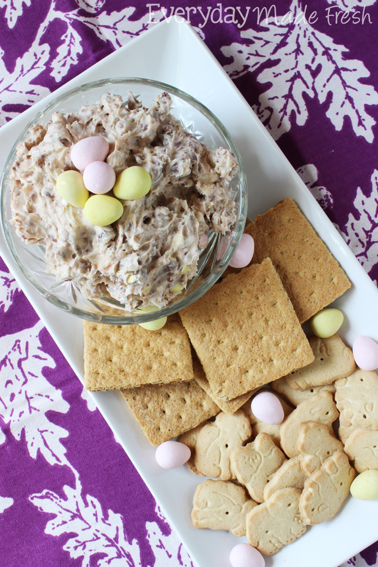 A cookie dough dip made with cream cheese, powdered sugar, and Cadbury Mini Eggs! This Cadbury Mini Egg Cookie Dough Dip is perfect for Easter! OHMY-CREATIVE.COM