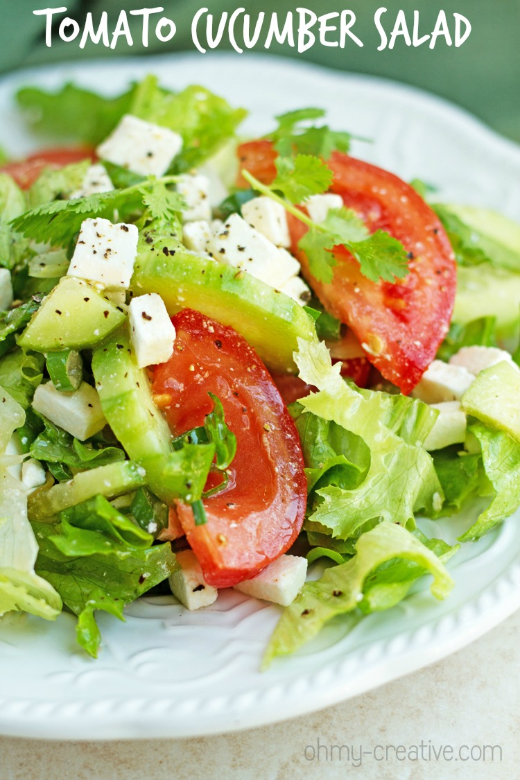 Tomato and Cucumber Feta Salad - Easy and healthy cucumber feta salad recipe with tomatoes, chive and freshly cracked pepper. Perfect for lunch or dinner. Light and delicious! I OHMY-CREATIVE.COM