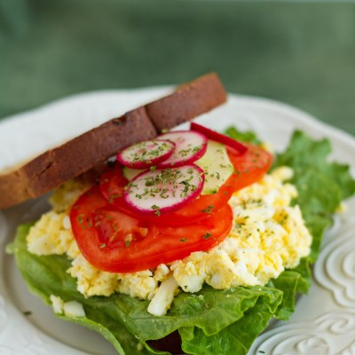 Homemade Egg Salad Sandwich Recipe Topped With Fresh Vegetables