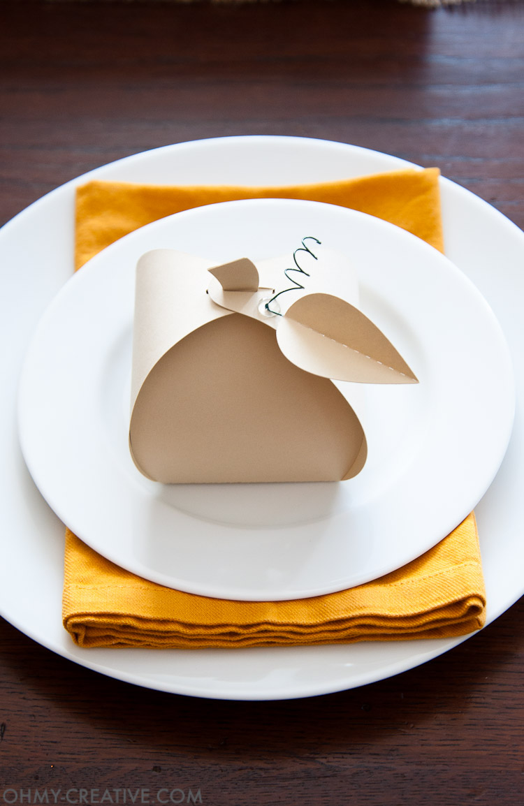 Make these easy paper pumpkins for your Thanksgiving table or any DIY Thanksgiving decorations. You can fill them with treats, use them as a place card, or just put them on your mantle to decorate. | OHMY-CREATIVE.COM
