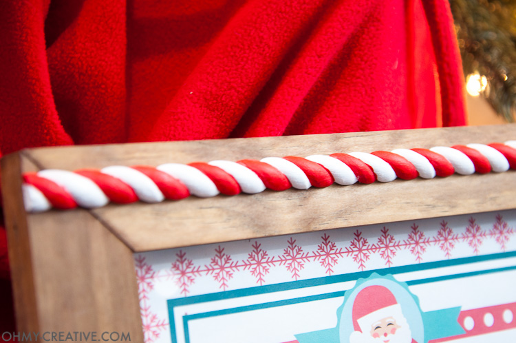 This is such a fun idea for a night before Christmas tradition! Let the kids know they made Santa's list with this easy DIY Christmas Photo Frame and a Nice List Certificate signed by Santa Claus. They will love going to bed knowing they will wake up to presents under the tree. | OHMY-CREATIVE.COM