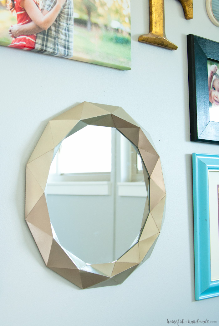 This beautiful Anthropologie knock-off mirror only cost $10 to make! You'll never guess what it is made out of. | Housefulofhandmade.com