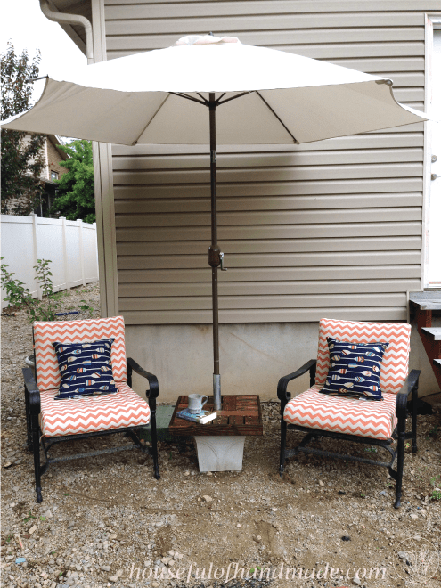 Create an umbrella stand with a side table for less than $10. Housefulofhandmade.com