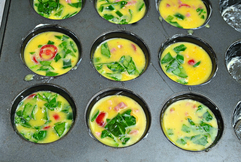 Raw Southwestern Healthy Egg Muffins mixture in muffin tins ready to be cooked