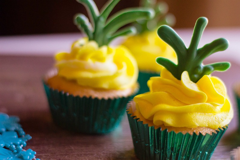 These Pina Colada Cupcakes are a tasty summer treat! Rum optional | OHMY-CREATIVE.COM | Pina Colada Cupcakes | Tropical Cupcakes | Pineapple Cupcakes | Pina Colada Cupcakes with Rum | Hawaiian Cupcake Recipes | #PinaColadaCupcakesrecipe #cupcakes #luau # pinacolada #dessert
