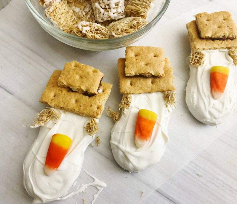 Create a hat for your scarecrow cookie by using shredded wheat and graham crackers. Check out our Cute Scarecrow Nutter Butter Fall Cookies for your harvest fest or Thanksgiving dessert buffet table! #Scarecrow #Scarecrowdessert #fallcookie #falldessert #thanksgivingdessert #nutterbutter