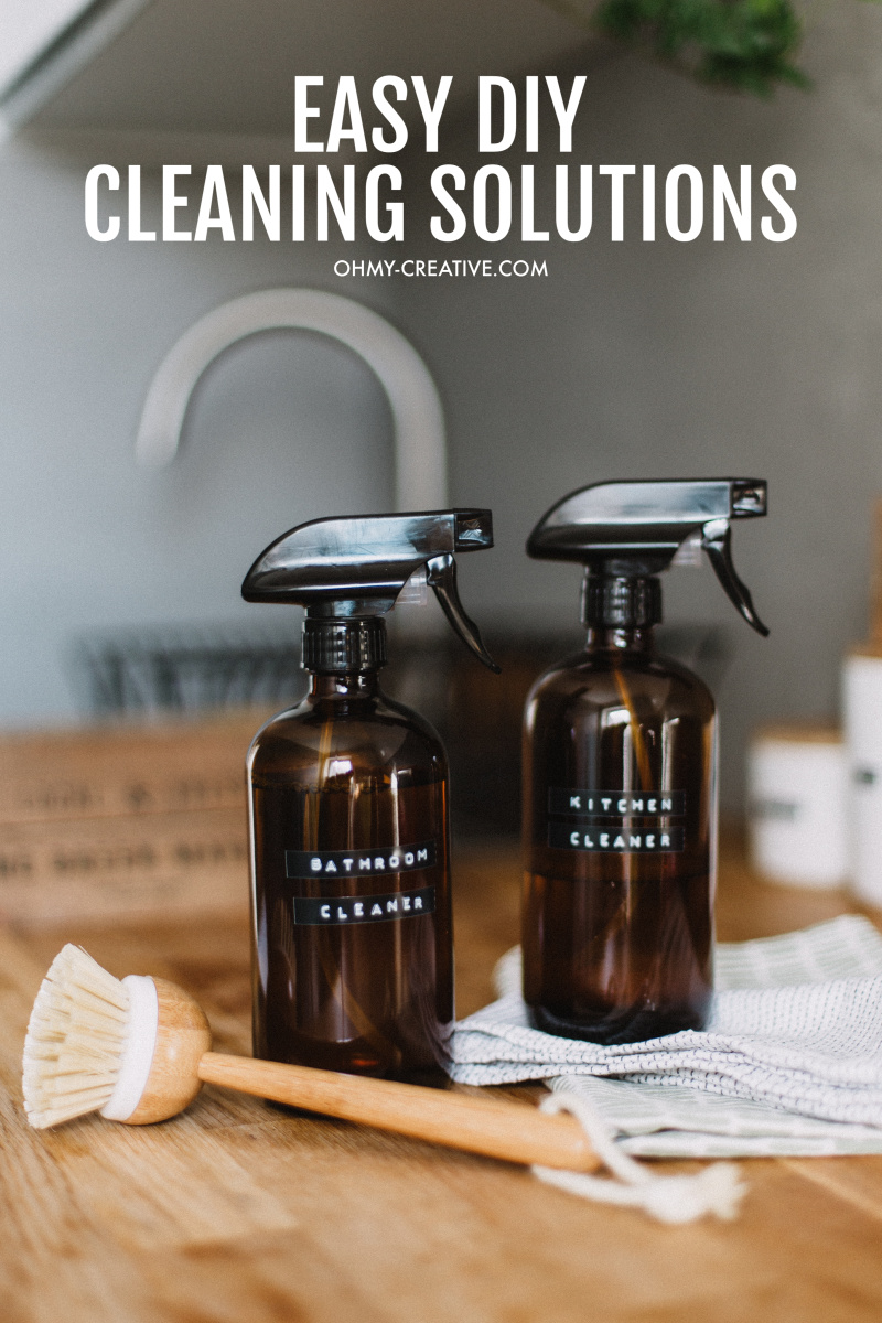 Instead of stocking up on over-the-counter cleaning supplies loaded with toxic chemicals, how about putting together a few DIY household cleaners that are all-natural, inexpensive, effective and smell great. OHMY-CREATIVE.COM #diycleaningproducts #chemicalfreecleaningproducts #homemadelaundrydetergent #diytoiletcleaner #diycleaner #homemadeglasscleaner #homemadecleaner #homemadecarpetcleaner