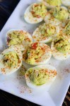 avocado deviled eggs on a plate