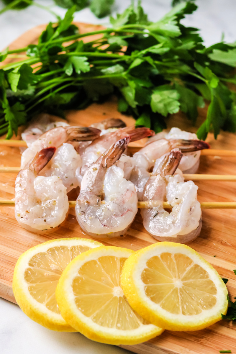 uncooked shrimp on skewers for grilling