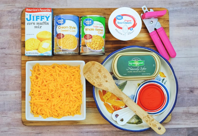 Displayed are all the ingredients to make a Jiffy Corn Casserole side dish.