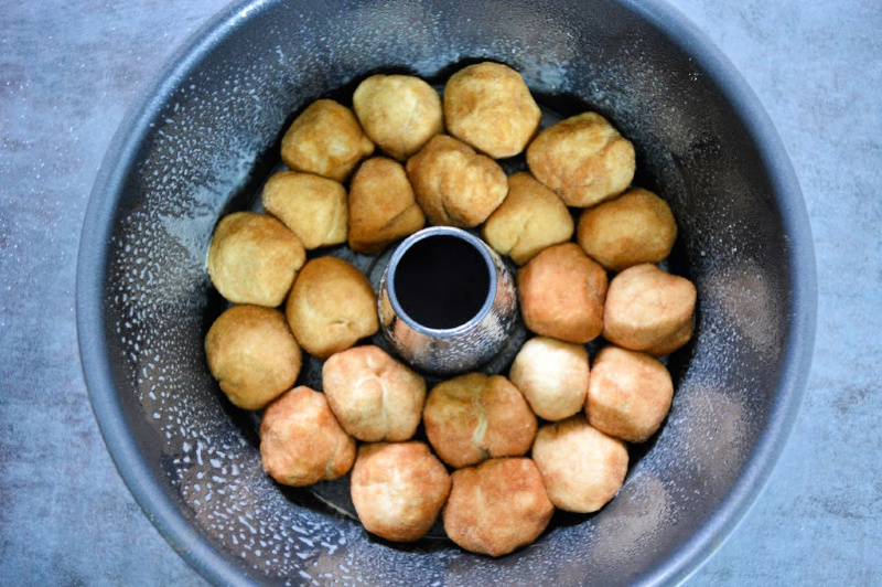 Rolled dough balls placed on the bottom of the baking pan