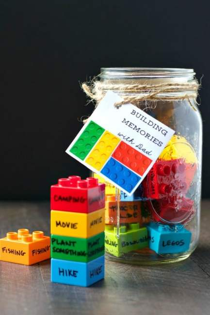 Mason Jar filled with LEGO pieces with written memories on each one