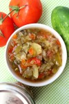 A bowl of sweet pickle relish surrounded by garden vegetables. Easy to can!