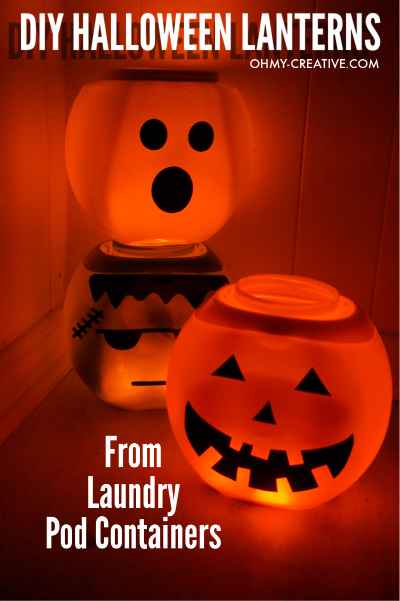 Stacked Halloween lanterns glowing with tealights place inside.