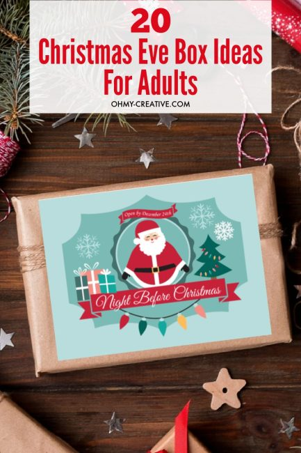 A Christmas gift with Christmas Eve Box Label on a wood background along with gift wrap supplies.