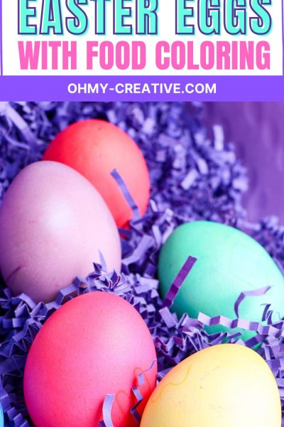 These Easter eggs are brightly colored with food coloring are nestled in purple Easter grass.