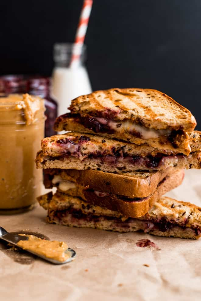 Grilled sandwiches made with brie cheese, peanut butter, and jelly. Stacked half sandwiches