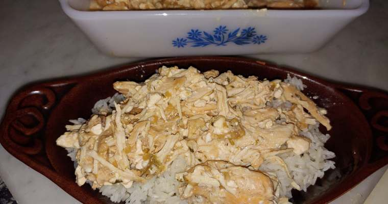 creamy chicken ranch on white rice on a brown tray