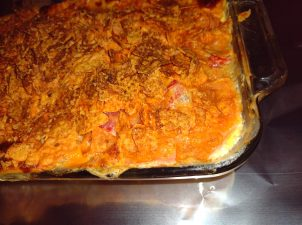 queso chicken in a casserole dish sitting on a chrome surfice