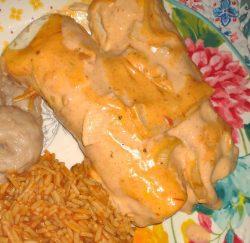 Super Cheesy Chicken Fajita Enchiladas with refried beans and Spanish rice