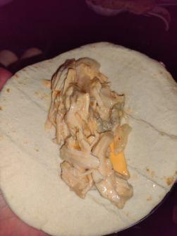 shredded chicken fajita meat in a tortilla