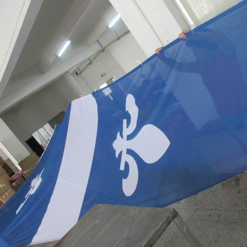 Production-of-32-Foot-high-Fabric-Mesh-Flag-Banner