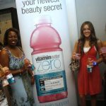 Tour guests pose with VitaminWater