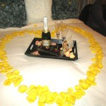 Wouldn't you like to see this gorgeous arrangement on your honeymoon bed?