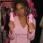 "Julia Davis from TruCHATonline holds up her ""re-styled"" Barbie doll"