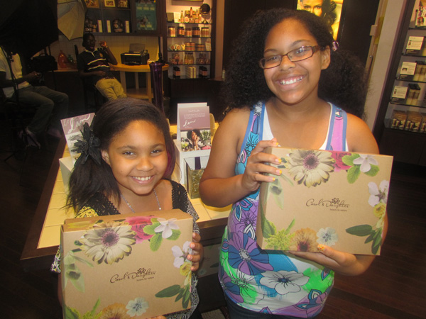 My daughters showing off the Carol's Daughter gift sets
